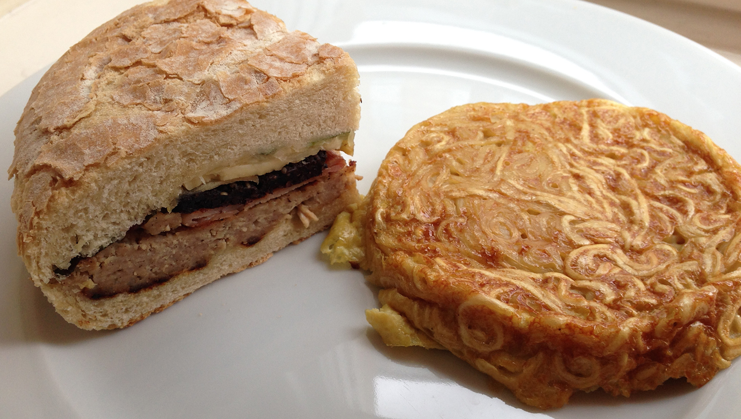 Breakfast boule sandwich with a cheeky curry ramen omelette thing