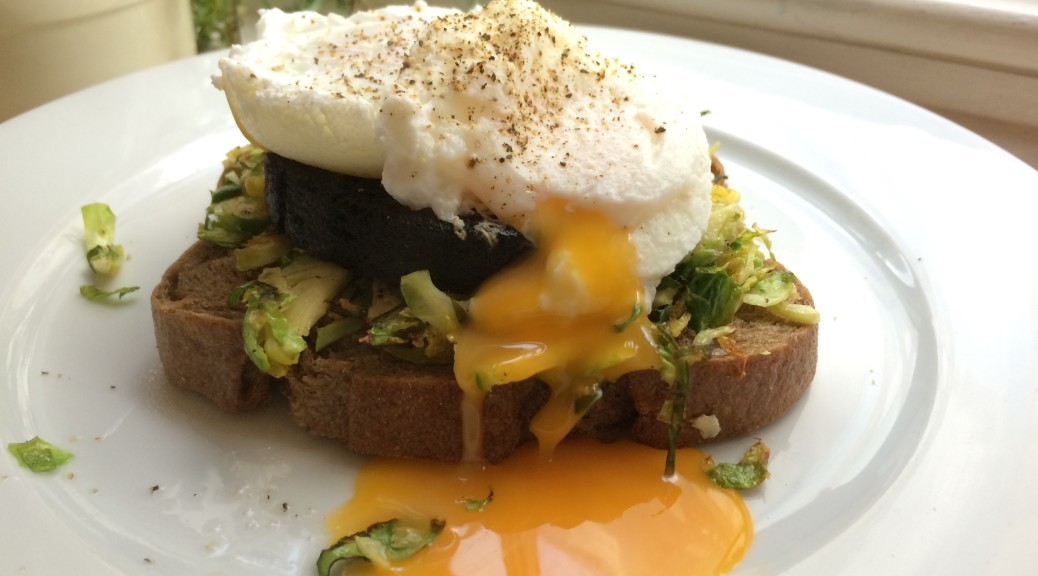 Poached egg, black pudding, shredded brussel sprouts on rye